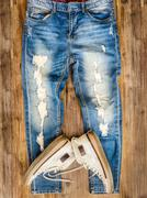 detail of vintage weathered jeans and shoes on wood texture - stock photo