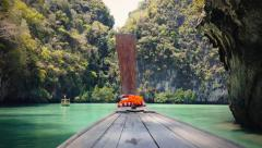 Thailand travel background. Exotic tropical island and wooden boat on sea. 4K - stock footage