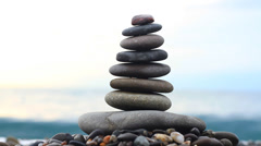 Stack of stones and Sea Splash 3 Stock Footage