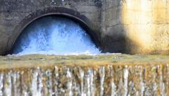 Water flowing from large drainage tunnels Stock Footage
