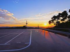 Empty parking during sunset Stock Photos