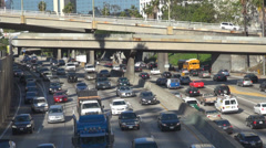 Busy freeway highway downtown Los Angeles multiple lane track commute travel USA Stock Footage