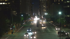 Busy boulevard avenue financial district Los Angeles USA night darkness commute  Stock Footage