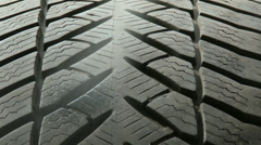 Stock Video Footage of 4K Maintaining Tire for Storage 2