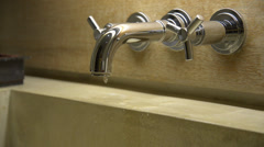 Dripping water from water tap - stock footage