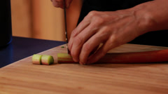 Action Shot of Cutting Rhubarb Stock Footage