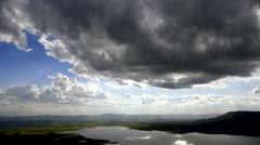 Cloudscape sun burst ray timelapse Stock Footage
