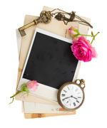Pile of old photos with antique clock, key and roses Stock Photos