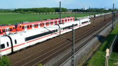 Commuter train passing by a high speed train - stock footage