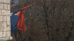 The flag in the wind in the city Nis, Serbia Stock Footage