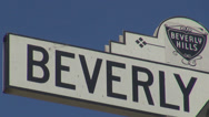 Stock Video Footage of Beverly hills street sign exclusive district luxury area boulevard avenue USA US