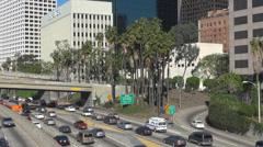 Busy highway freeway traffic car Los Angeles commuter traveler street building  - stock footage
