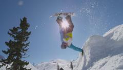 SLOW MOTION: Snowboarding handplant over the sun Stock Footage