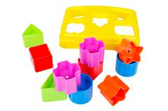 shape sorter toy with various coloured blocks isolated - stock photo