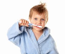 boy brushing his teeth - stock photo