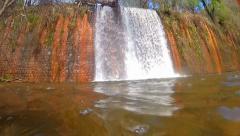 Going underwater in waterfall hidden in tropical rainforrest Stock Footage