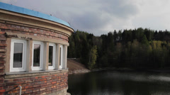 Panning view over the dam at the local reservoir in Central Europe - stock footage