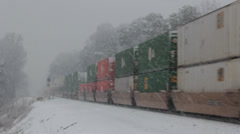 Freight Train Passes on a Wintry Day Stock Footage