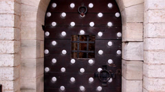 The big metal door of the old castle Stock Footage