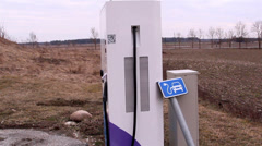 An electric car charger Stock Footage