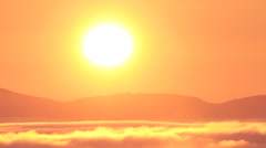 Sunrise time lapse over fog-filled mountain valley Stock Footage