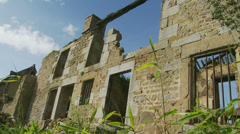 Low angle shot of derelict house - dolly Stock Footage