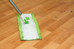 mop cleaning parquet - stock photo