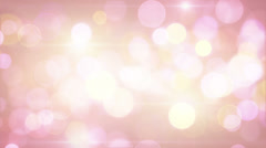 Light-coloured pink yellow circle bokeh lights loop background Stock Footage