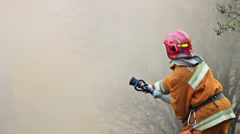 firefighter puts out fire - stock footage