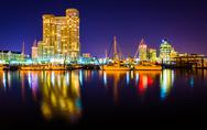 Stock Photo of marina and apartment building at night in baltimore, maryland.