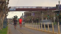 Timelapse traffic street people run walk pass car pedestrian bike San Francisco  Stock Footage
