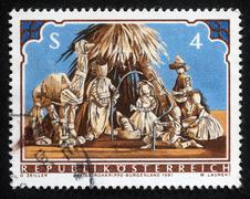 Christmas stamp printed in the Austria shows Christmas Creche Stock Photos
