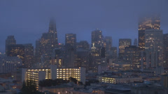 San Francisco business tower skyscraper skyline urban twilight light night USA  Stock Footage
