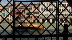 Venice view through lattice on the grand canal Stock Footage