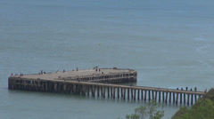 Aerial view beautiful wooden pontoon bridge tourism attraction ocean water sea  Stock Footage