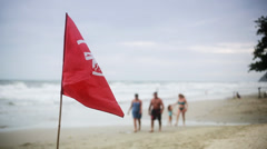 Red warning flag on the beach Stock Footage