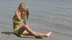 4K Child, Little Girl Playing on Coastline, Beach, Kid in Waves, Children - stock footage