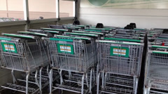 Rows Of Shopping Carts In A Supermarket Stock Footage