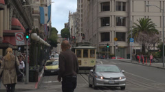 Cable car famous downhill San Francisco city railway passenger enjoy travel tour Stock Footage
