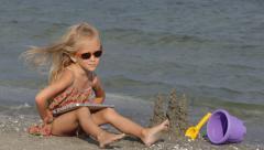 4K Child on Tablet, Girl Playing on Beach, Kid Surfing PC, Ipod, Seashore, Coast Stock Footage