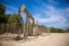 Horsehead pumpjack with a blue sky background Stock Photos
