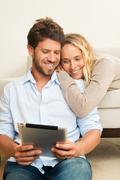 Stock Photo of young couple using tablet computer
