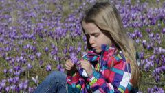 4K Child Playing Crocus Flowers, Meadow, Portrait Happy Little Girl, Children Stock Footage