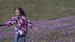 4K Child, Kid Running, Playing Violets Flowers, Meadow, Field, Happy Little Girl - stock footage