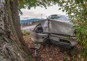 Car wreck off the road after a fatal accident Stock Photos