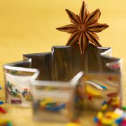 star anise on christmas tree cookie cutter - stock photo
