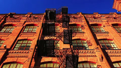 Red brick building with fire escape Stock Footage