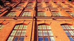 Facade of a red brick building - stock footage
