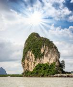 Dramatic sky over Thailand Sea with Big Rock and Vegetation Stock Photos