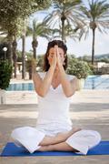Woman meditating in lotus yoga Kuvituskuvat